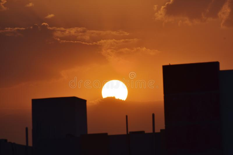 Rising Sun cached from my window. A beautiful View of Golden hour in cloudy sky royalty free stock photo