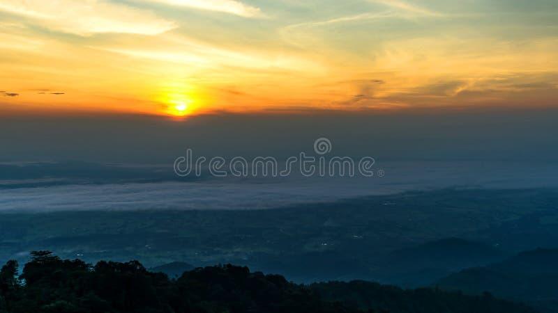 Phu tub Berk. Rising sun in the early morning over sea of fog on hill of Phu Tub Berk in Phetchabun, Thailand stock photo