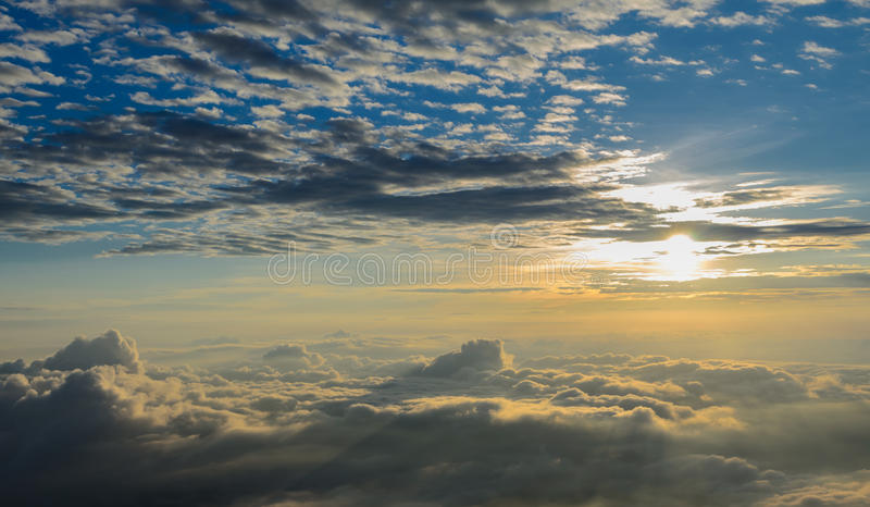 Rising sun in the early morning over sea of mist royalty free stock photo