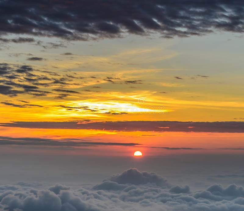 Rising sun in the early morning over sea of mist. Beautiful nature landscape of rising sun in the early morning over sea of mist stock photos