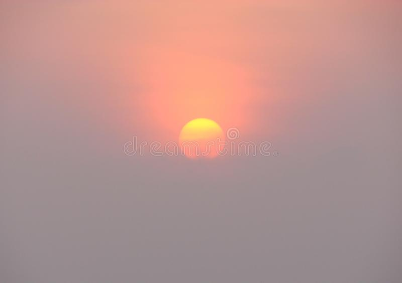 The Rising Sun with Golden Yellow and Red Hues. This is a photograph of the rising sun, captured at Promenade Beach, Pondicherry, India... The sun is half yellow stock images