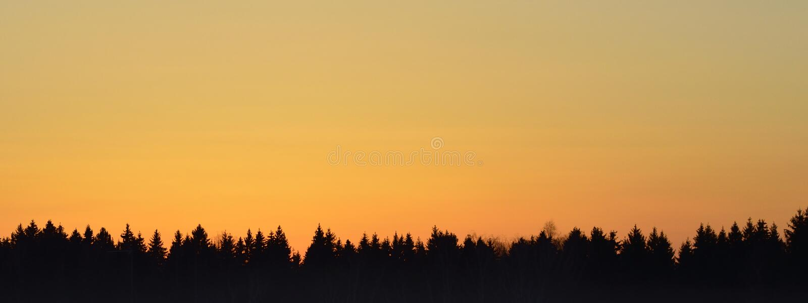 The rising sun on the horizon royalty free stock photos