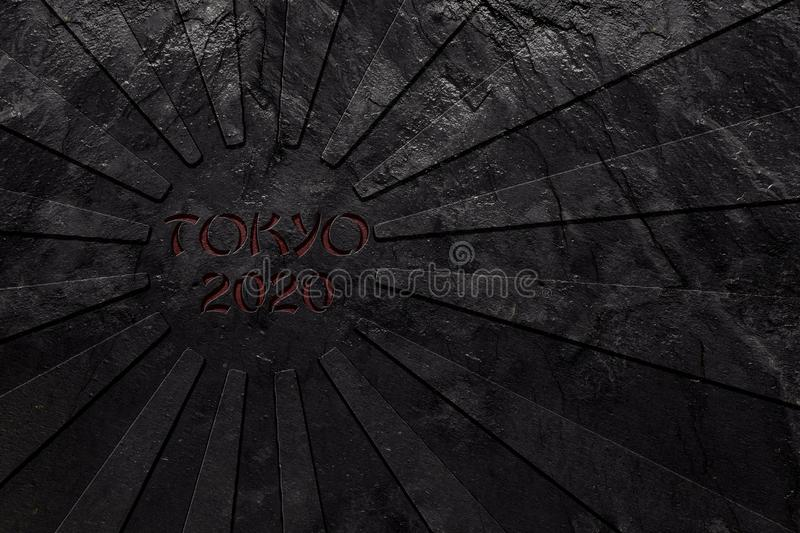Rising Sun japan flag and Tokyo 2020 text carved in black slate. Stone. Olympic concept royalty free stock photos