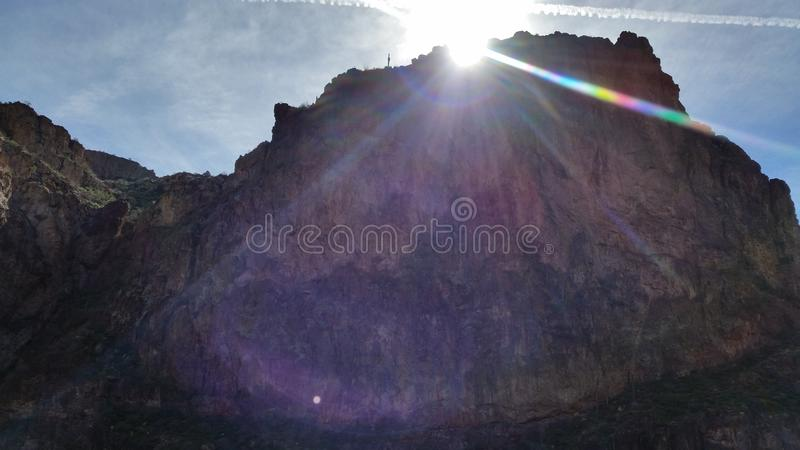 Rising Sun. The sun is just barely making it over the mountain at Canyon Lake, Arizona royalty free stock image