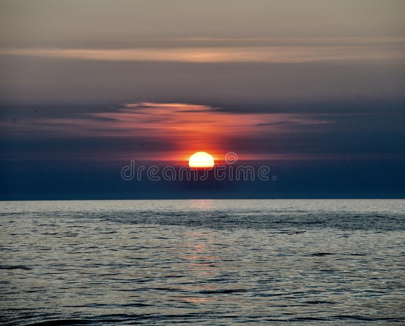 A Rising Sun Through Marine Layer #2. This is an early morning Summer picture of a rising sun through the marine layer on Lake Michigan off Diversey Harbor royalty free stock photo