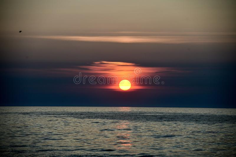 A Rising Sun Through Marine Layer #4. This is an early morning Summer picture of a rising sun through the marine layer on Lake Michigan off Diversey Harbor royalty free stock photography