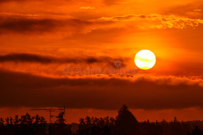 Rising sun in the morning. Rising sun with orange warm colour in the morning stock photography