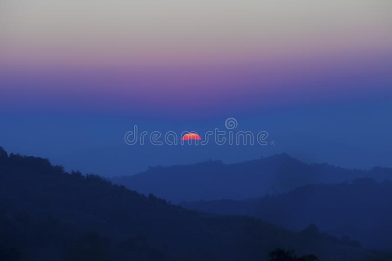 Rising sun from the mountain, Thailand.Landscape of mountain high view with sun rise in the morning at Chiangrai, Thailand.  royalty free stock photo