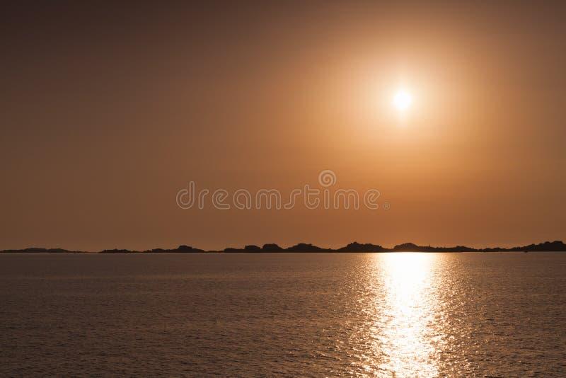Rising sun over horizon of Bonifacio, Corsica royalty free stock images