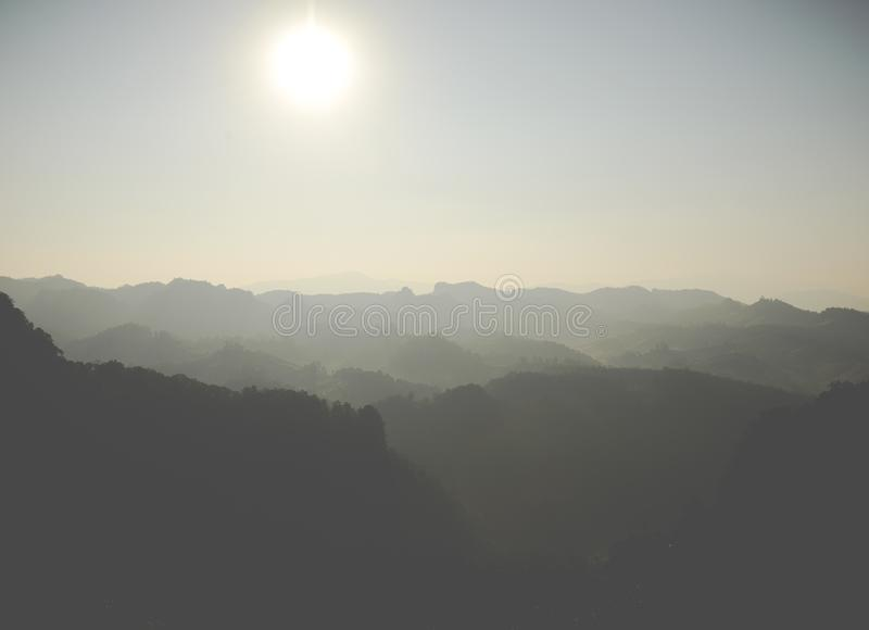 The rising of the sun over a mountain range.  royalty free stock image