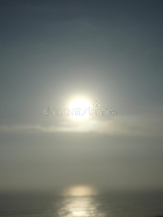 Rising sun over sea with early winter clouds royalty free stock photos