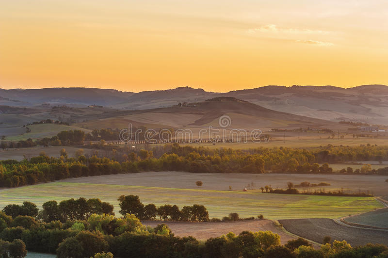 The rising sun over the Tuscan fields. In Val d'Orcia royalty free stock photos