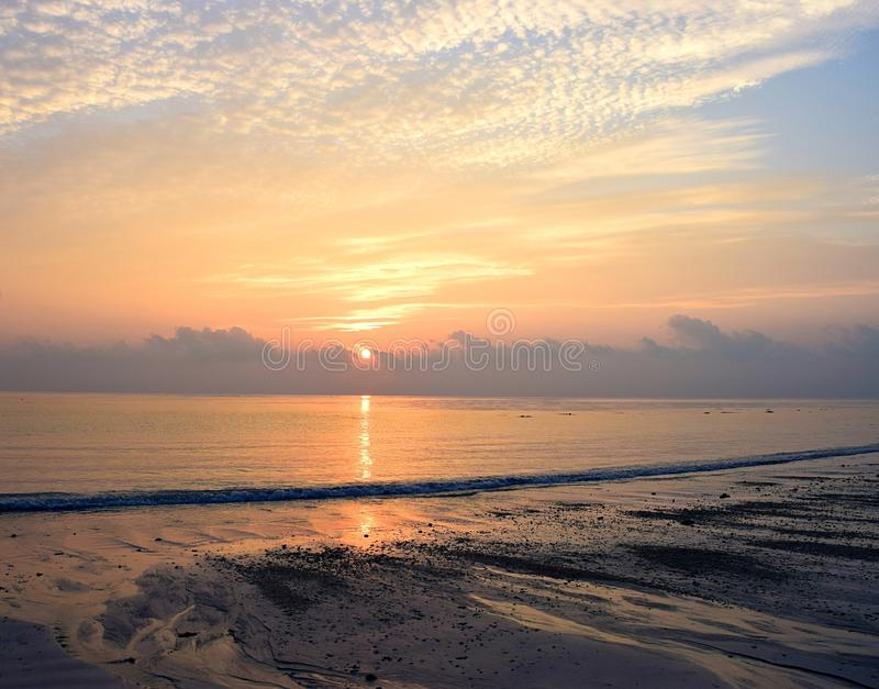 Rising Sun with Reflection in Ocean Water at Kalapathar Beach, Havelock Island, Andaman with Bright Colors in Sky royalty free stock photos