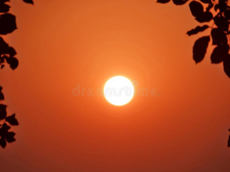 Rising sun. Looks like ring of fire royalty free stock photo