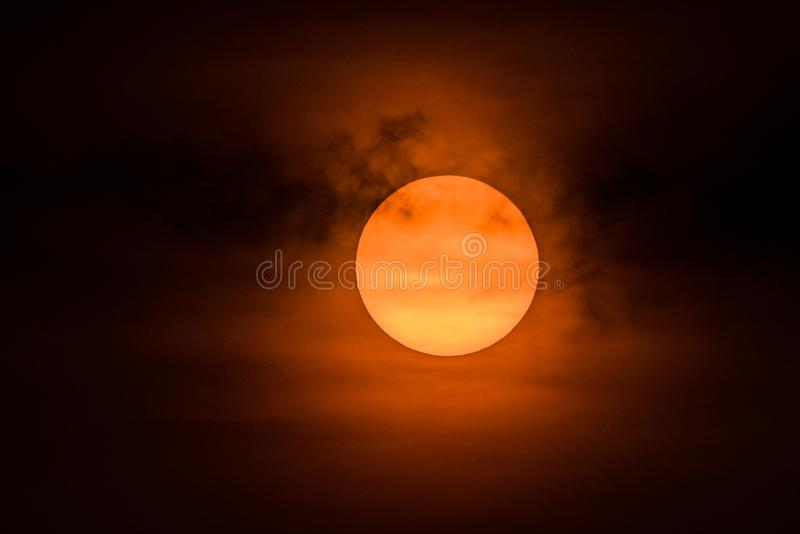 The Rising Sun. With moring mist and clouds stock photography