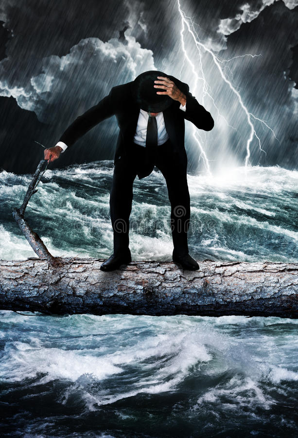 Risk. A suited man standing on a log over a raging river. Lightening flashes in the background over the stormy waters. Concept for risk taking and danger