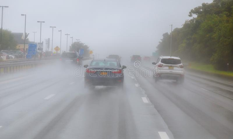 Rainy weather in road traffic. Risk of accident during heavy rainfall stock photos