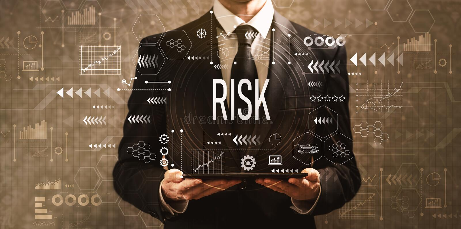 Risk with businessman holding a tablet computer. On a dark vintage background stock images