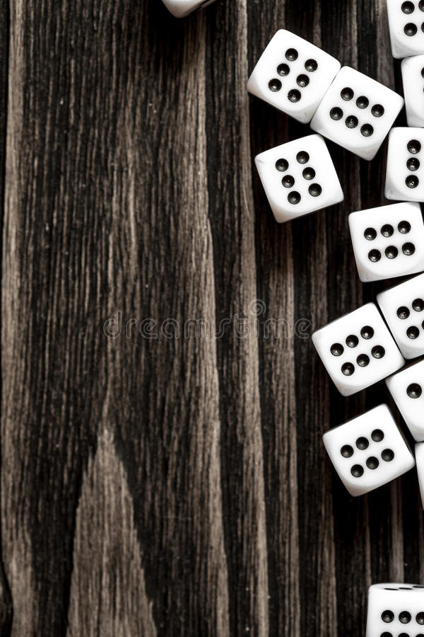 Risk concept playing dice at dark wooden background top view. Risk concept - playing dice at dark wooden background top view stock photography