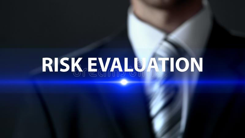 Risk evaluation, man in business suit standing in front of screen, analytics royalty free stock image
