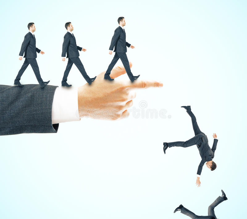 Risk and failure concept. Abstract image of businessmen walking and falling off pointing hand on blue background. Risk and failure concept royalty free stock images