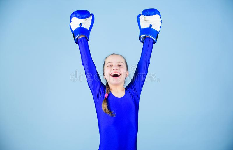 Risk of injury. Female boxer change attitudes within sport. Rise of women boxers. Girl cute boxer on blue background. Risk of injury. Female boxer change royalty free stock photos