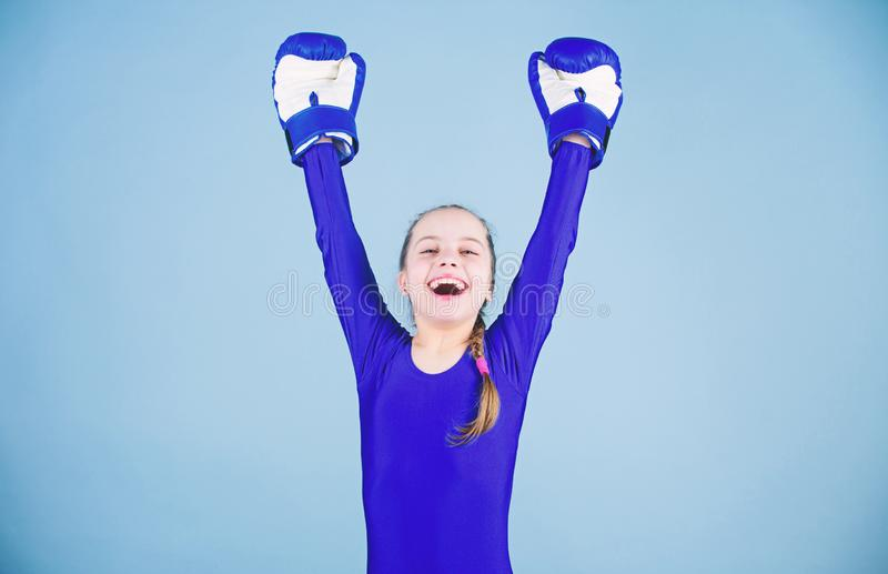 Risk of injury. Female boxer change attitudes within sport. Rise of women boxers. Girl cute boxer on blue background. Risk of injury. Female boxer change stock photos