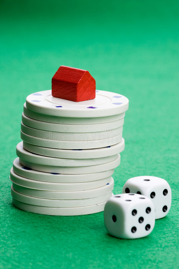 Risk Real Gamble. Casino chips with toy house - housing market gamble concept royalty free stock photos