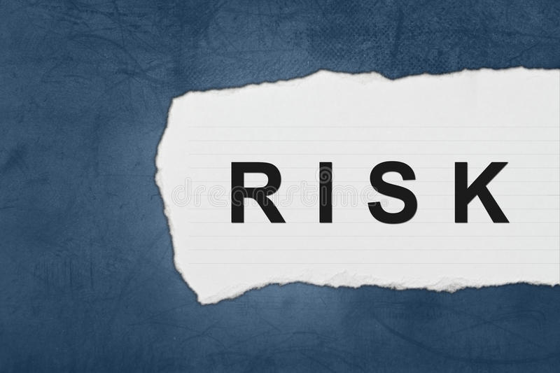 Risk with white paper tears. On blue texture royalty free stock photography