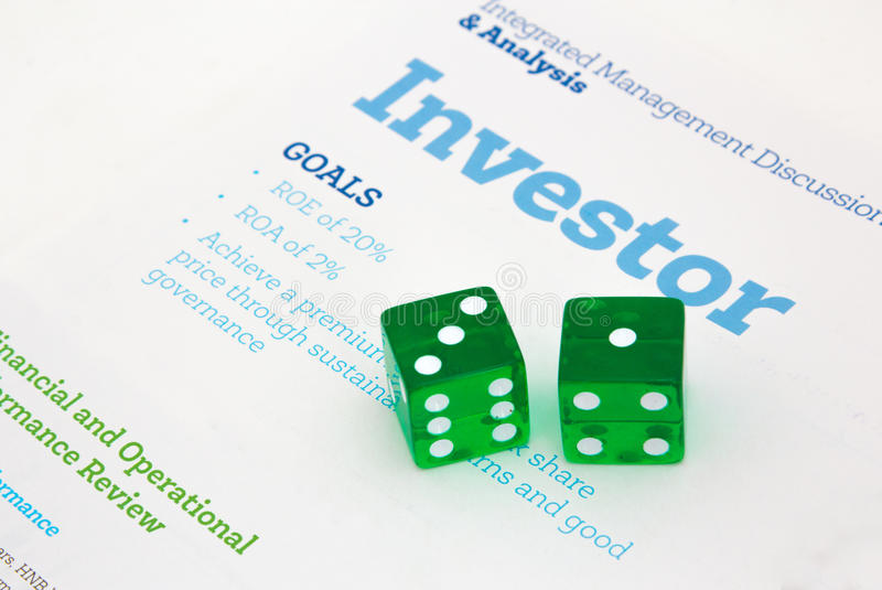 Risky Investor. Imaging with a financial report and dice depicting a gambling or risk taking investor royalty free stock photo