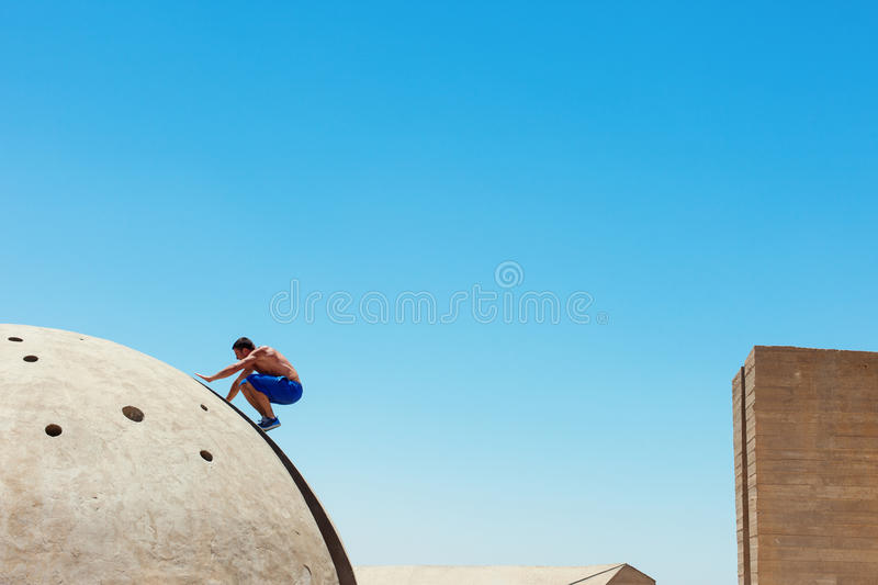Risky man on the edge. Risky man jumping, in little motion blur royalty free stock photo