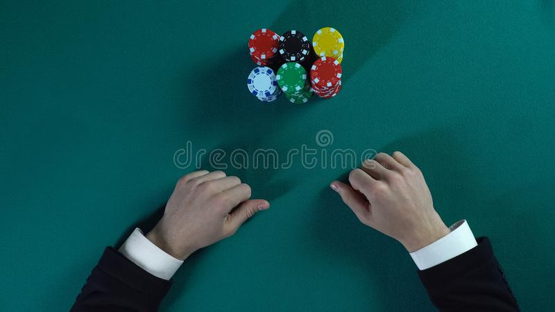 Risky poker player bets all-in, man stakes money on business project, gambling royalty free stock photography