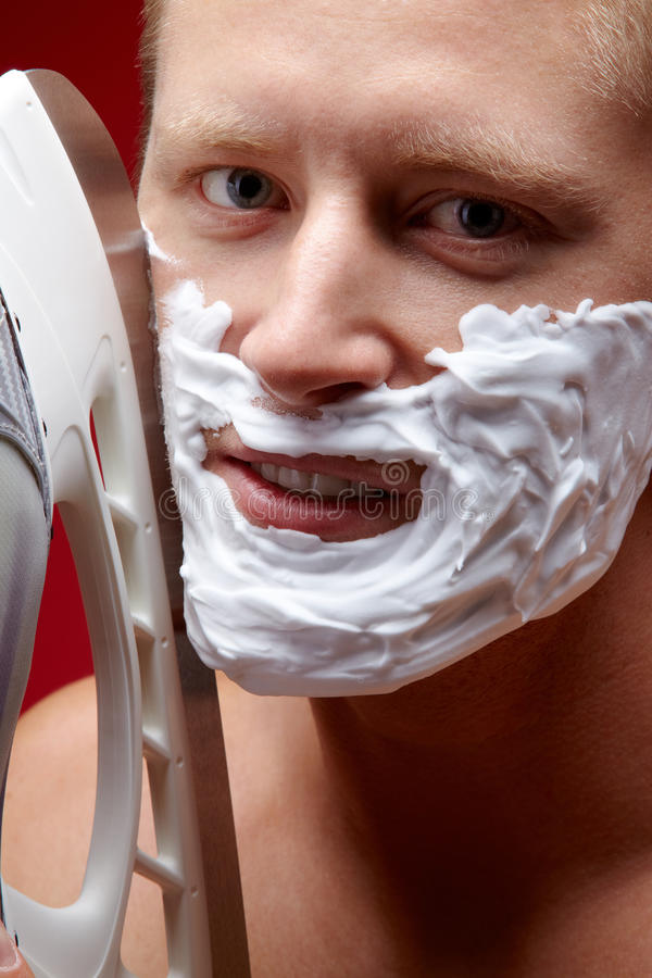 Risky shaving royalty free stock photo