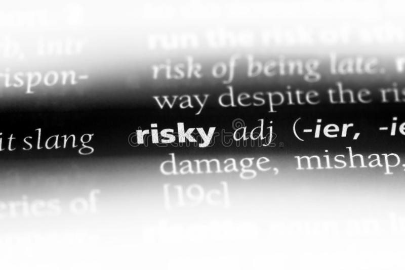 Risky. Word in a dictionary.  concept royalty free stock photos