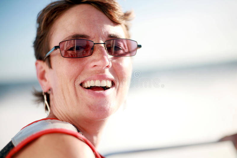 Riso da mulher fotografia de stock royalty free