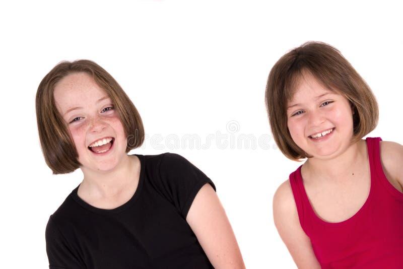 Riso de duas meninas foto de stock royalty free