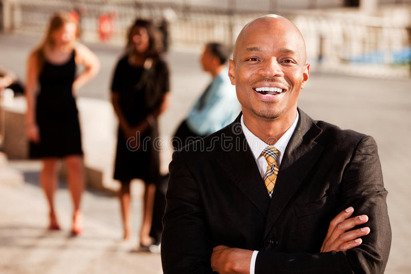 Riso do homem de negócio foto de stock royalty free