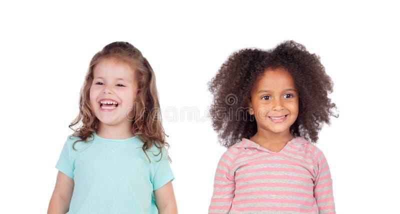 Riso engra?ado de duas crian?as fotografia de stock royalty free