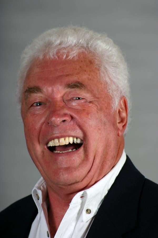 Riso maduro do homem fotografia de stock royalty free