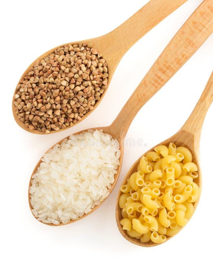 Riso, pasta e grano saraceno in cucchiaio immagine stock libera da diritti