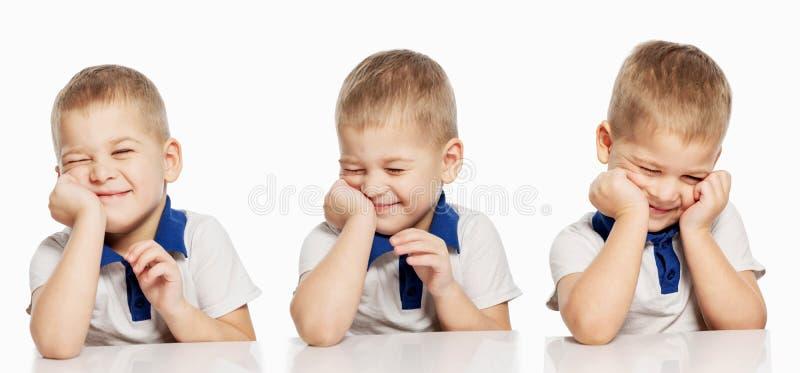 Risos bonitos do rapaz pequeno, isolados no fundo branco, colagem foto de stock royalty free