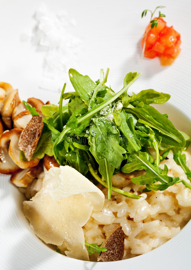 Risotto. With Rucola, Tartufo Bianco (White Truffle) and Porcini and Tomato royalty free stock images