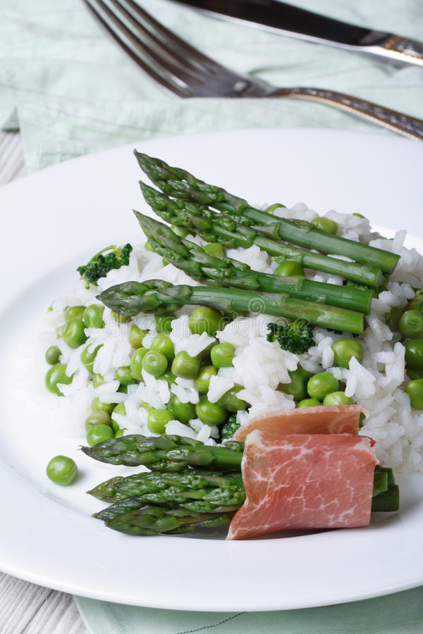 Risotto with asparagus and green peas vertical royalty free stock images
