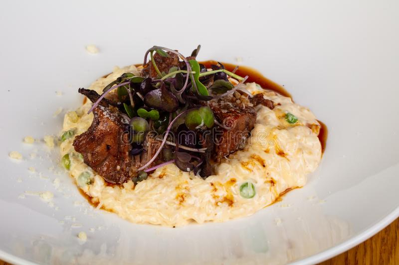 Risotto with beef stock images