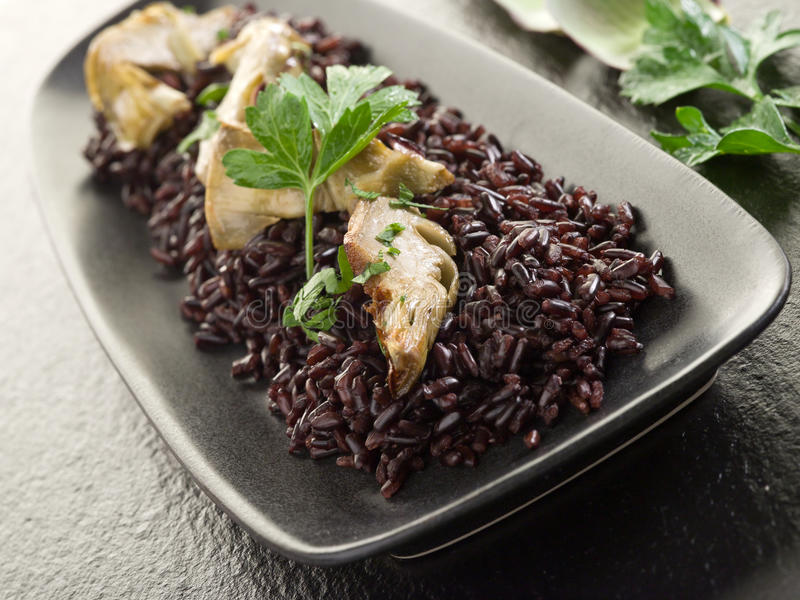 Risotto com arroz preto imagens de stock