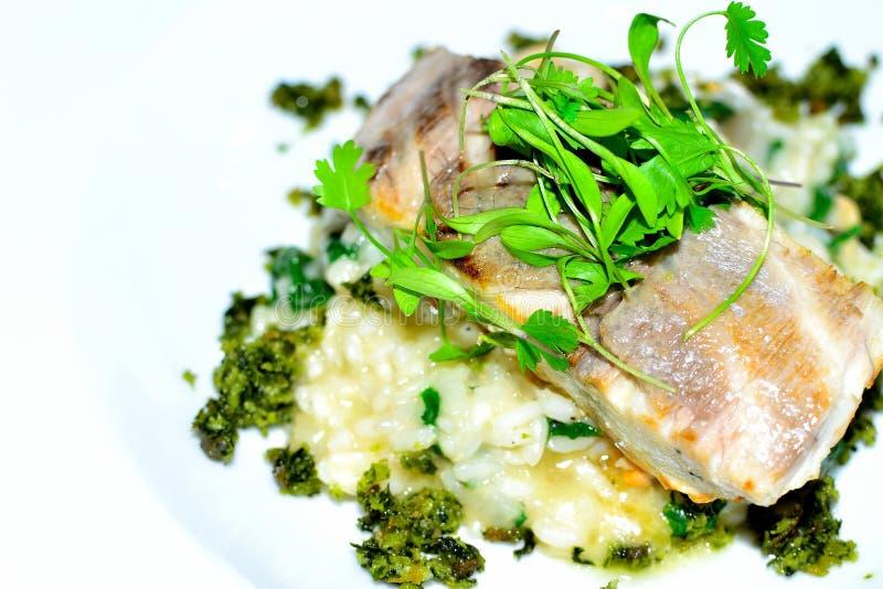 risotto del riso e del pesce bianco immagini stock