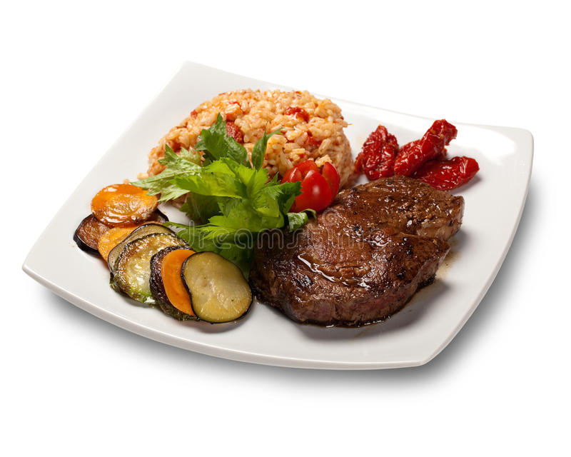Risotto with fillet mignon steak royalty free stock photo