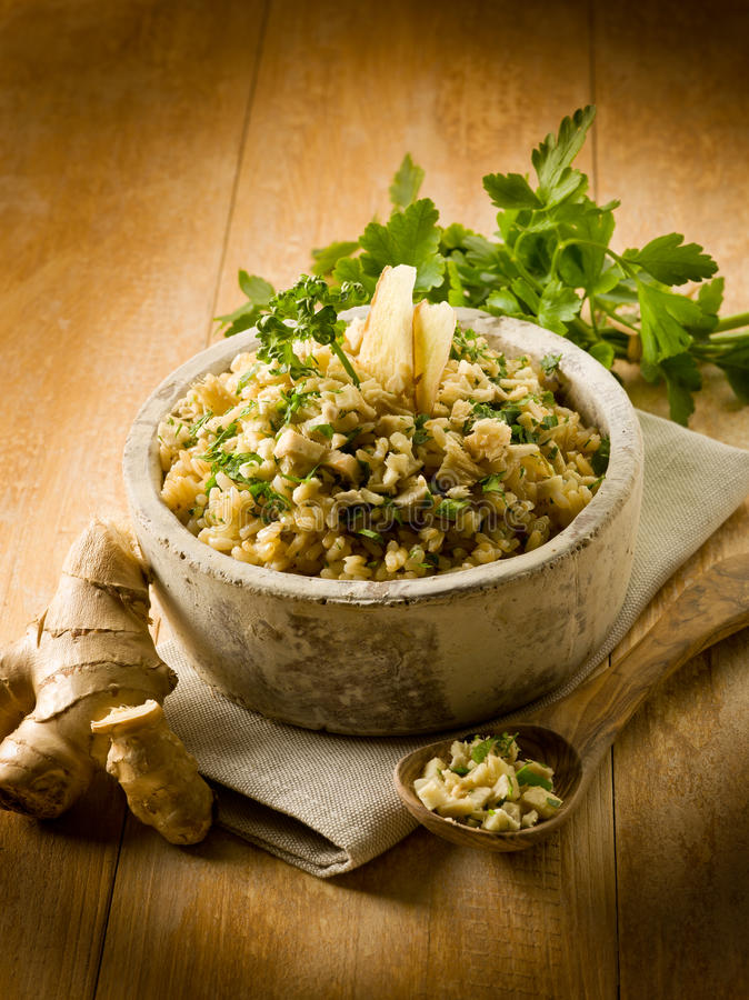 Download Risotto With Ginger And Parsley Royalty Free Stock Photos - Image: 24329148