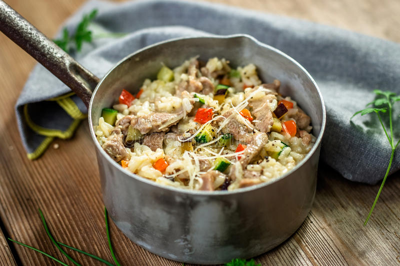 Risotto with meat and vegetable royalty free stock image