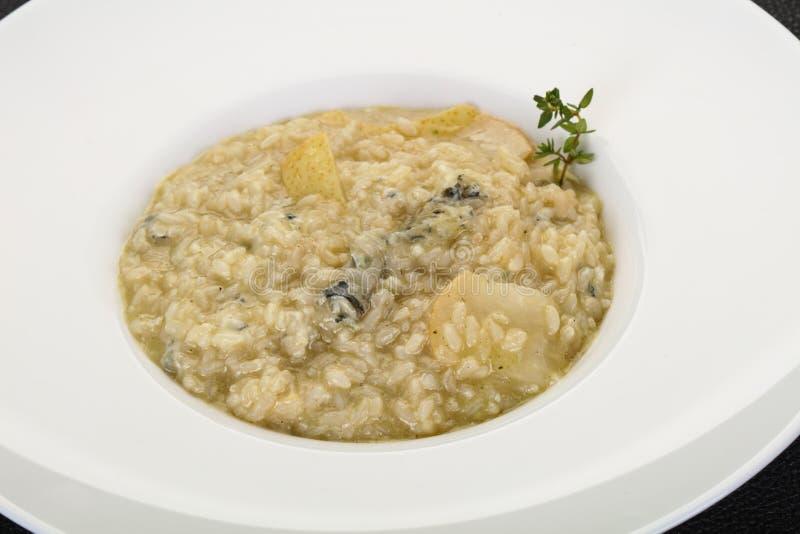 Risotto med p?ronet och gorgonzola arkivfoton